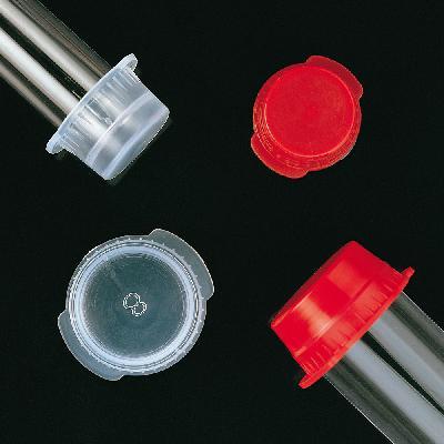 Bouchons coiffants pour tubes sous vide