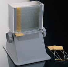 Automatic slide dispenser